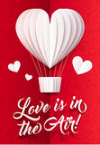 White paper heart shape vector balloon with Love is in the Air sign on red ornate background, vector greeting card Royalty Free Stock Images