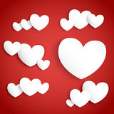 White paper hearts on red background Stock Photos