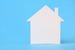 White paper house on blue Royalty Free Stock Photos