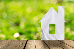 White paper house and spring green grass Royalty Free Stock Images