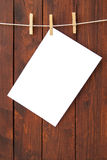 White paper hung on laundry line Stock Photo