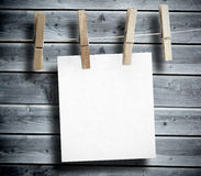 White paper hung on laundry line Stock Images
