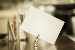 White paper for a message on a desk -aged photo style Royalty Free Stock Photos