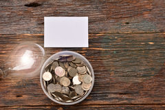 White paper mock up,light bulb for idea and stack coins in glass Stock Photo