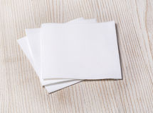 White paper napki. N on old wooden table Royalty Free Stock Photography