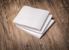 White paper napkin. On old wooden table Royalty Free Stock Photography