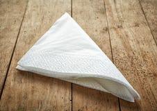 White paper napkins. On wooden table Stock Photos
