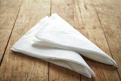 White paper napkins. On wooden table Stock Photo