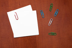 White paper note with a clip Stock Images