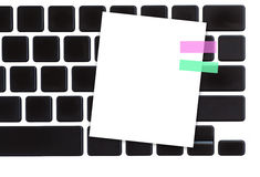 White paper note on computer keyboard Royalty Free Stock Image