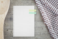 White paper note  and kitchen utensils for food recipes Stock Photo