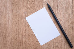White paper note and pencil on wooden background Stock Photo