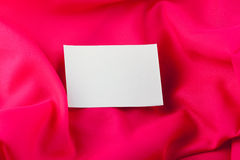 White paper note on red silk Royalty Free Stock Photos