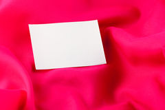 White paper note on red silk Stock Image