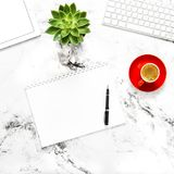White paper notebook tablet pc working desk Flat lay. White paper, notebook, tablet pc on working desk. Flat lay Stock Photos