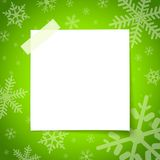 White paper notes. With adhesive tape placed on the surface of a green christmas royalty free illustration