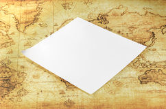 White paper on a old world map Stock Photography