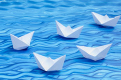 White paper origami boats Stock Photos