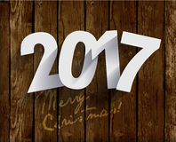 2017 White Paper Origami Happy New Year card on wood background. 2017 White Paper Origami Happy New Year card on realistic wood background Stock Images