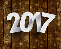 2017 White Paper Origami Happy New Year card on wood background. Royalty Free Stock Images