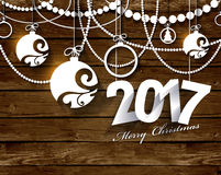 2017 White Paper Origami Happy New Year card on wood background. Stock Photos