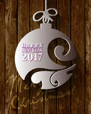 2017 White Paper Origami Happy New Year card on wood background. Stock Image