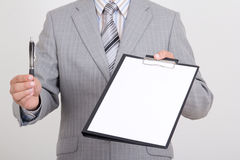 White paper and pen in business man hands Stock Image