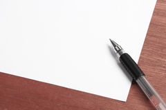 White Paper and Pen On Desk Royalty Free Stock Images