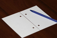 White paper with pen on wood table Royalty Free Stock Image