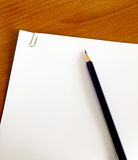 White paper with pencil Royalty Free Stock Image