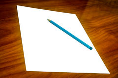 White Paper with pencil on Desk Royalty Free Stock Photo