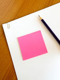 White paper with pencil and memo on table Royalty Free Stock Image