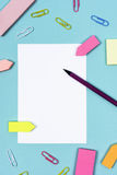 White paper pencil paperclips and reminder color papers Royalty Free Stock Image