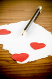 White paper with pencil and red heart Stock Photo