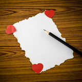 White paper with pencil and red heart Royalty Free Stock Photography