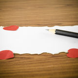 White paper with pencil and red heart Royalty Free Stock Image