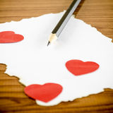 White paper with pencil and red heart Stock Image