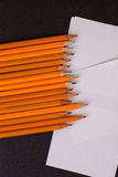 White paper and pencil on wood table Stock Photography