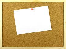White paper with a pin to corkboard Royalty Free Stock Photos