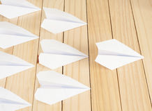 White paper plane leading ones Stock Photography