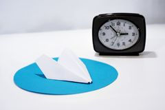 White paper plane on round blue circle. Abstract photo royalty free stock image