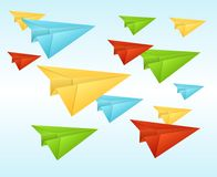 White paper planes on blue sky. Royalty Free Stock Image