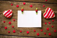 White paper postcard with cookies hearts Royalty Free Stock Photography