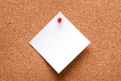 White paper with red clip nailed on wooden board Stock Photography