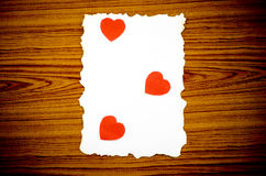 White paper and red heart Stock Images