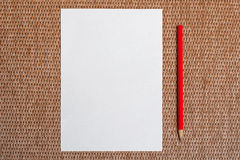 White paper and red pencil on background Stock Images