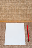 White paper and red pencil on background Royalty Free Stock Image