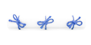 White paper scroll tied with string, three blue knots isolated. White paper scroll tied with string, three blue knots, isolated stock image