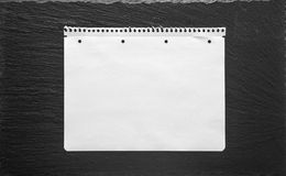 White paper sheet on black background. School book page Royalty Free Stock Images