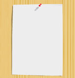 White paper sheet and motley pins on wood texture Royalty Free Stock Photography